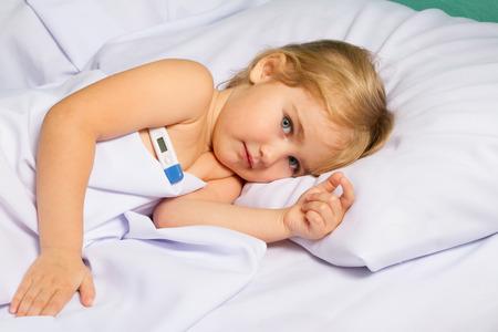 49533710 - sick little girl in bed.virus, flu, cold, fever.